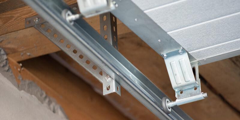 repair rollers and tracks - Supreme Garage Door Repair