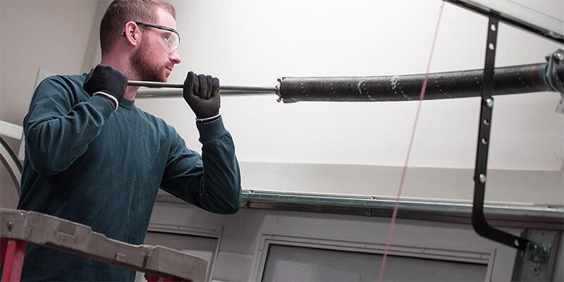 garage door coil spring - Supreme Garage Door Repair