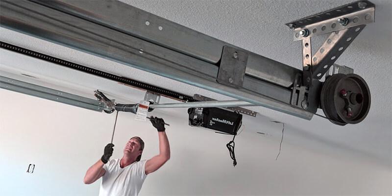 installing garage door springs - Supreme Garage Door Repair